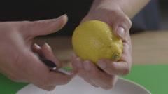 Zesting a lemon Stock Footage