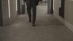 Man Walking Indoors With Suit Case Stock Footage