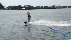 Young Boy Wakeboarding Stock Footage