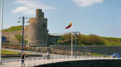 ABERYSTWYTH, WALES, UK - CIRCA 2016 - lithuanian flag waving in wind Stock Footage