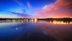 Night landscape on the lake with blue sky and clouds - stock photo