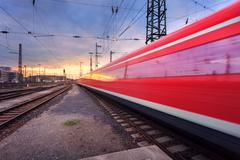 High speed passenger train on railroad track in motion - stock photo