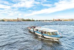 Tourist boats traveling along the Neva River. - stock photo