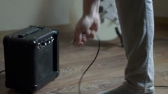 Plug out jack cable from the mini guitar amplifier Stock Footage