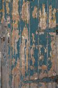 Wooden door with flaky painted boards Stock Photos