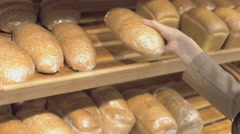 Customer chooses the bread in a supermarket Stock Footage