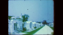 1967: Above ground tombs city of the dead cemetery graves family giving respect. Stock Footage