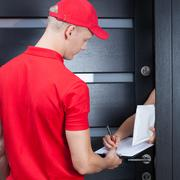 Courier waiting for a signature - stock photo