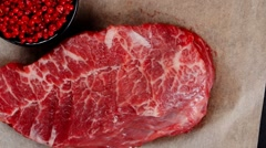 Raw beef meat marble steak on paper Stock Footage
