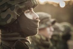 Close up of a uniformed soldier standing with pride - stock photo
