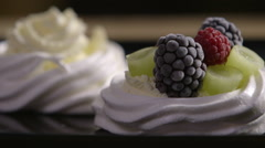Meringue with cream and fruit Stock Footage
