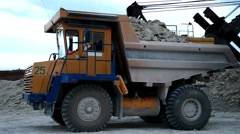 Heavy mining dump truck being loaded with iron ore Stock Footage