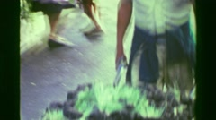 1978: Happy farmer pushing wheelbarrow sod grass plants to marketplace. MEXICO Stock Footage