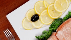 Healthy food fresh roast red fish with kale Stock Footage