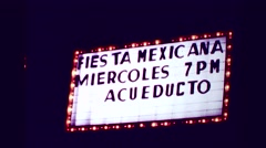 1978: Fiesta Mexicana Miercoles 7pm Acueducto neon flashing marquee sign. Stock Footage