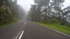 Foggy low visibility mountain road driving misty forest day Asturias Spain POV   - stock footage