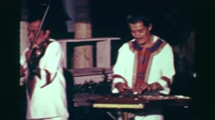 1978: Mariachi 4 piece band playing music outdoor night party zone. ACAPULCO, Stock Footage
