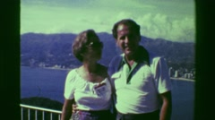 1978: Happy tourists posing above Acapulco bay at lookout mountain. ACAPULCO, Stock Footage