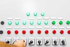 On & off switch, hand switching button - stock photo