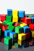 Colorful toy blocks with reflections Stock Photos