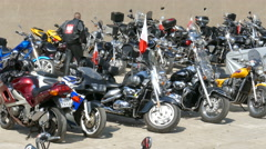 Motorcycle rally. Motorbikes on a car park. Motorcyclist watching motorbike Stock Footage