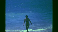 1978: Sexy bikini clad swimming woman coming out of ocean beach. ACAPULCO, - stock footage