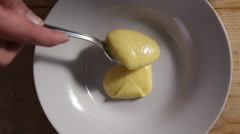 Spooning hollandaise sauce into a bowl - stock footage