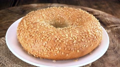 Portion of Sesame Bagels (seamless loopable; 4K) - stock footage