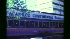 1978: Acapulco Continental resort hotel skyscraper building guest room tower. Stock Footage