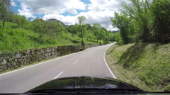 Driving countryside green forest mountains POV car hood Asturias Spain timelapse - stock footage