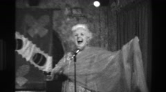 1944: Cheesy vaudeville senior woman entertainment performer singing musician Stock Footage