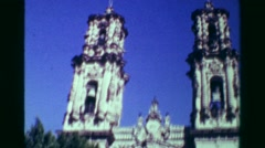 1978: Religious church cathedral building tilt down blue sky sunny day. Stock Footage