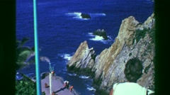 1978: Famous cliff diving rocks of La Quebrada monument statue zoom. ACAPULCO, - stock footage