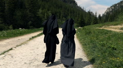 Nuns hiking in mountains, super slow motion 240fps Stock Footage