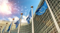 European Union flags in front of European Commission building. Brussels, Belgium Stock Footage