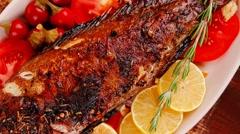 Savory: whole fryed sunfish over wood Stock Footage