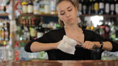 Bartender wipes a wine glass. Medium shot - stock footage