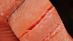 Salmon fillet served on dark plate with lemon and white wine in wineglass Stock Footage