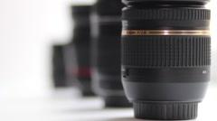 Photo lenses on white background - stock footage