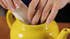Bartender prepares tea in a teapot. Close up - stock footage
