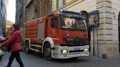 ROME, ITALY - OCTOBER 3RD 2015: Firemen fire man truck put out a house fire Stock Footage