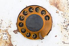 Old public rotary phone - stock photo