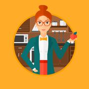 Young woman with apple in the kitchen - stock illustration