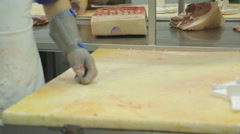 Process of separating meat from bone as a butcher close-up Stock Footage