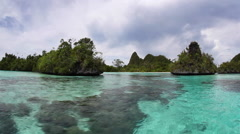 Shallow Lagoon and Limestone Islands in Raja Ampat Stock Footage