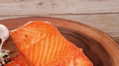 Roast salmon fillet with dry spices garlic and rosemary Stock Footage