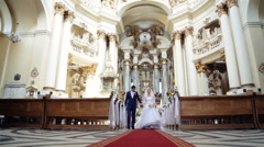 Bride and groom leaving the church after a wedding ceremony - stock footage