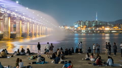 Rainbow fountain show at Banpo Bridge in Seoul, Korea. - stock footage