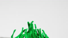 Green chroma key paint on white background shot in slow motion Stock Footage