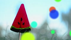 Red Lollipop in the shape of watermelon slices.Rotation and cartoon effect. Loop - stock footage